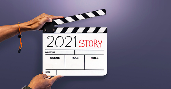 Hollywood style clapboard with 2021 story written on it