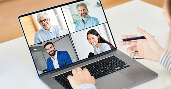 laptop showing video conference with 4 people of diverse ages and gender
