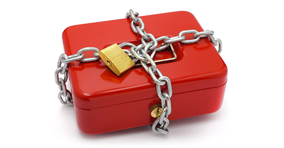 red cash box with chain and padlock around it.