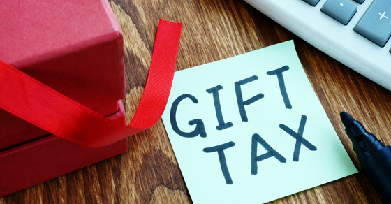 corner of a present with a post it note that says gift tax