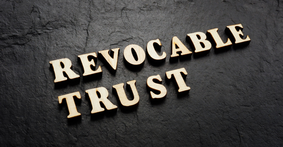black background with raised gold letters reading REVOCABLE TRUST