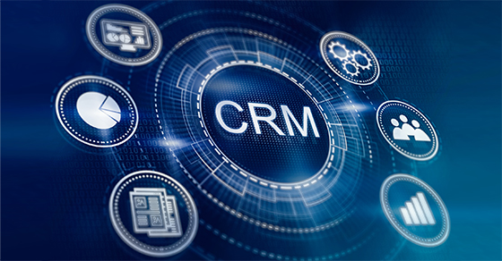 Icon showing CRM as hub and several smaller icons representing teams, statistics, reports, graphs as spokes from crm.