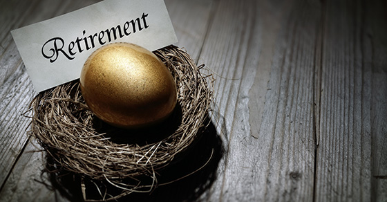 bird nest with golden egg and note that says retirement in it.