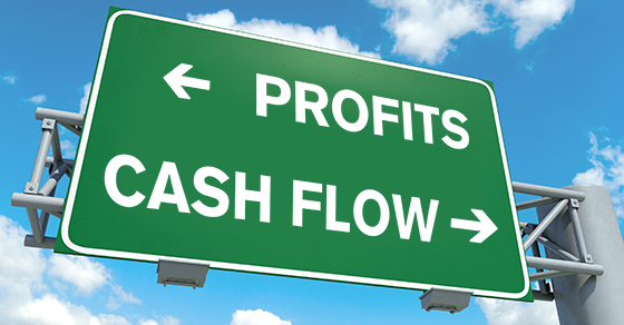 road sign with arrow showing profits to the left and cash flow to the right