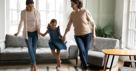 3 generations of women dancing in living room