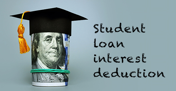 """roll of $100 bills held with a rubber band and with a graduation cap on top of roll.  Words """"Student Loan interest deduction"""" beside money roll.  All on blue background"""